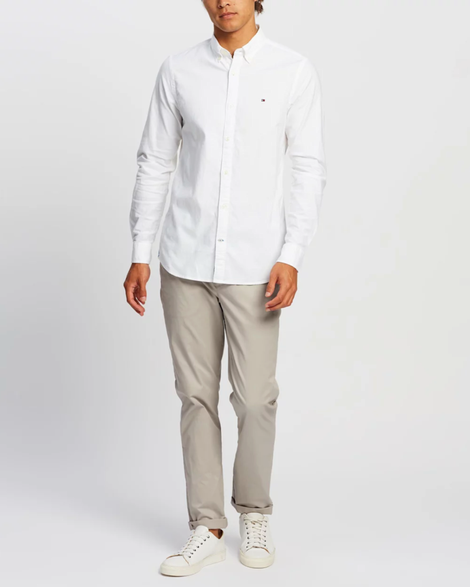 Man wars Tommy Hilfiger button-down from The Iconic.