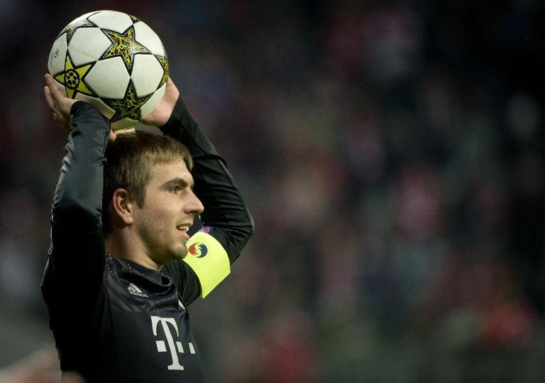 Bayern Munich's defender Philipp Lahm throws a ball in a match against Lille OSC in Munich on November 7, 2012