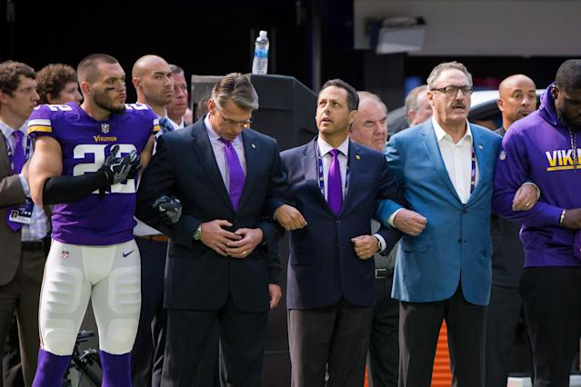 <p>Minnesota Vikings defensive back Harrison Smith (22) locks arms with general manager Rick Spielman (left) and owner Mark Wilf (middle) and owner Ziggy Wilf (right) before the game against the Tampa Bay Buccaneers at U.S. Bank Stadium. Mandatory Credit: Brad Rempel-USA TODAY Sports </p>