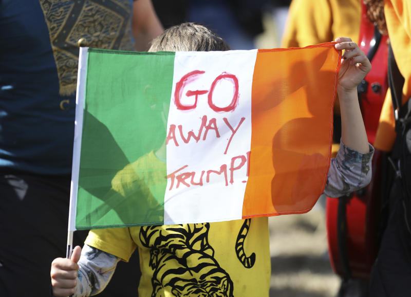 A demonstrator protests before the arrival of U.S President Trump at Shannon Airport in the west of Ireland, Wednesday, June 5, 2019. President Trump is staying overnight in Ireland before attending 75th anniversary of the D-Day landings events in northern France Thursday. (AP Photo/Peter Morrison)