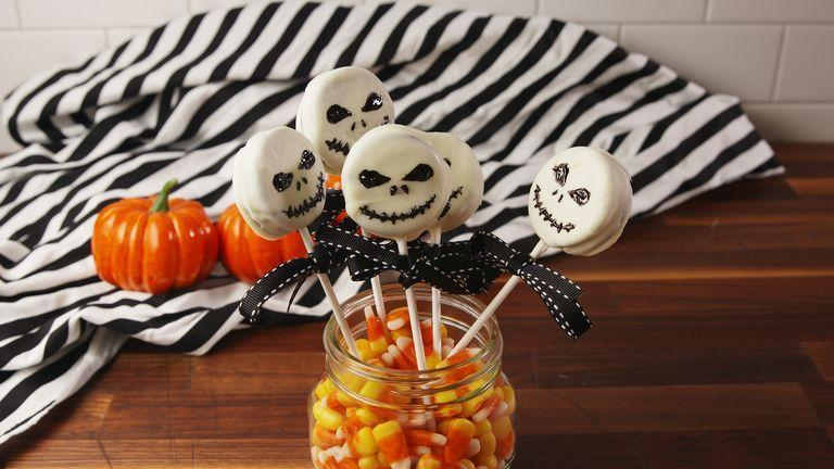 """<p>Turn Oreos into a party-ready treat with white chocolate, black icing, and festive ribbon.</p><p><em><a href=""""https://www.delish.com/cooking/recipe-ideas/recipes/a55618/jack-skellington-oreo-pops-recipe/"""" rel=""""nofollow noopener"""" target=""""_blank"""" data-ylk=""""slk:Get the recipe from Delish »"""" class=""""link rapid-noclick-resp"""">Get the recipe from Delish »</a></em></p>"""