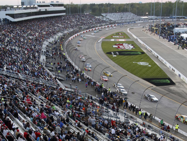 Fans watch the NASCAR Cup Series auto race at Richmond Raceway in Richmond, Va., Saturday, April 21, 2018. (AP Photo/Steve Helber)