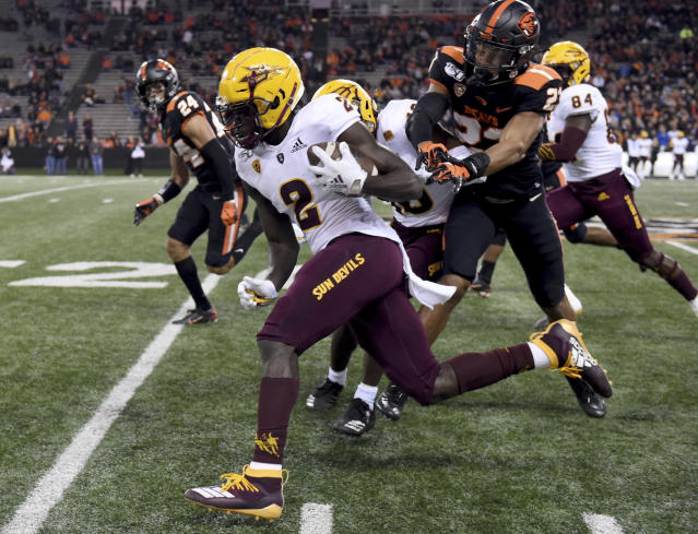 Arizona State wide receiver Brandon Aiyuk dashes past Oregon State defensive back Isaiah Dunn during the first half of an NCAA football game in Corvallis, Ore., Saturday, Nov. 16, 2019. (AP Photo/Steve Dykes)