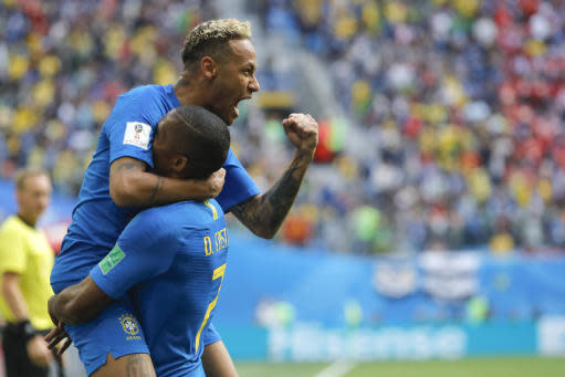 Brazil's Neymar, top, celebrates with teammate Douglas Costa after scoring his side's second goal during the group E match between Brazil and Costa Rica at the 2018 soccer World Cup in the St. Petersburg Stadium in St. Petersburg, Russia, Friday, June 22, 2018. (AP Photo/Dmitri Lovetsky)