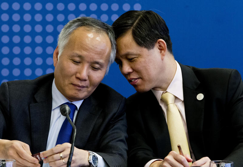 Tran Quoc Khanh, Vietnam's Deputy Minister of Industry and Trade, left, talks with Singapore's Industry and Trade Minister Chan Chun Sing, during a meeting of the Comprehensive and Progressive Agreement for Trans-Pacific Partnership, CP TPP, in Santiago, Chile, Thursday, May 16, 2019. (AP Photo/Esteban Felix)