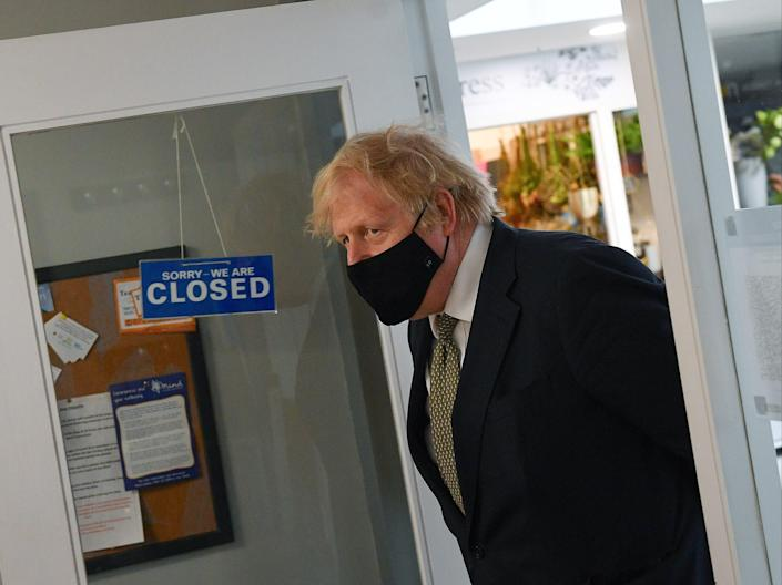 <p>Boris Johnson visits businesses in Truro, England, ahead of the relaxation of restrictions on 12 April</p> (Getty Images)