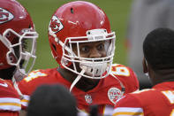 Kansas City Chiefs defensive tackle Mike Pennel talks with teammates on the sideline during the second half of an NFL divisional round football game against the Cleveland Browns, Sunday, Jan. 17, 2021, in Kansas City. (AP Photo/Reed Hoffmann)