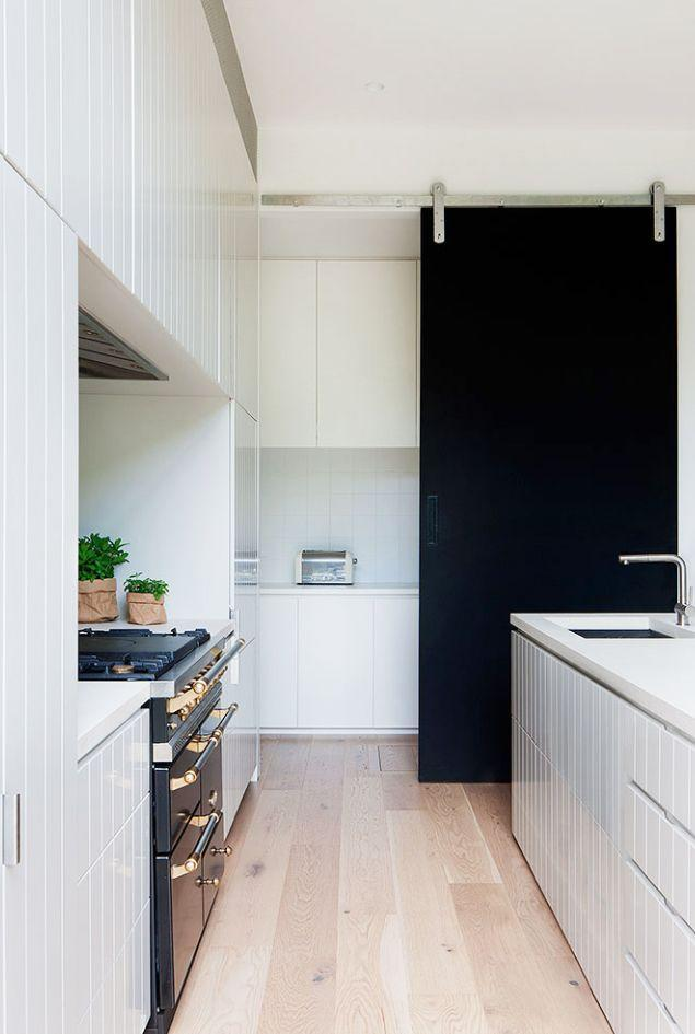 "<p>If your panty is basically just the kitchen cabinets and exposed in plain sight, consider installing a sliding door that tucks them away and brings in new depth. This tall black sliding door in a <a href=""https://www.robsonrak.com.au/"" rel=""nofollow noopener"" target=""_blank"" data-ylk=""slk:Robson Rak"" class=""link rapid-noclick-resp"">Robson Rak</a>-designed kitchen tucks away the toaster and other appliances. </p>"