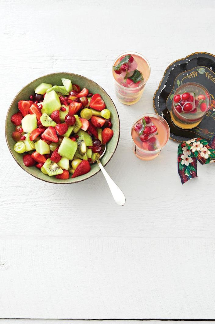 """<p>Keep these cranberry ice cubes on hand during the holidays to turn any drink into a festive sip. This grape punch is a great pick!</p><p><strong><a href=""""https://www.thepioneerwoman.com/food-cooking/recipes/a34704080/white-grape-punch-with-cranberry-ice-recipe/"""" rel=""""nofollow noopener"""" target=""""_blank"""" data-ylk=""""slk:Get Ree's recipe."""" class=""""link rapid-noclick-resp"""">Get Ree's recipe.</a></strong></p><p><a class=""""link rapid-noclick-resp"""" href=""""https://go.redirectingat.com?id=74968X1596630&url=https%3A%2F%2Fwww.walmart.com%2Fsearch%2F%3Fquery%3Dpioneer%2Bwoman%2Bpitcher&sref=https%3A%2F%2Fwww.thepioneerwoman.com%2Ffood-cooking%2Fmeals-menus%2Fg34703383%2Fchristmas-punch-recipes%2F"""" rel=""""nofollow noopener"""" target=""""_blank"""" data-ylk=""""slk:SHOP PITCHERS"""">SHOP PITCHERS</a></p>"""