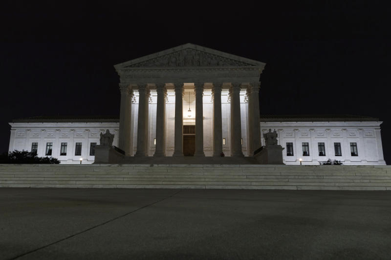 FILE - In this July 16, 2019, file photo, the Supreme Court is seen in Washington. The Supreme Court is allowing nationwide enforcement of a new Trump administration rule that prevents most Central American immigrants from seeking asylum in the United States. The justices' order late Wednesday, Sept. 11, temporarily undoes a lower court ruling that had blocked the new asylum policy in some states along the southern border.  (AP Photo/Carolyn Kaster)