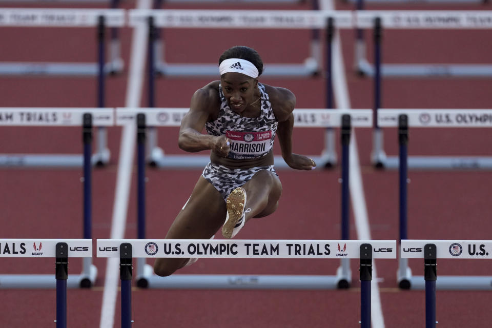 Keni Harrison wins the the second semi-final in the women's 100-meter hurdles at the U.S. Olympic Track and Field Trials Sunday, June 20, 2021, in Eugene, Ore. (AP Photo/Ashley Landis)