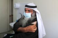 A Palestinian man waits to be vaccinated against the coronavirus disease (COVID-19), in Gaza City