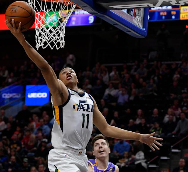 Dante Exum blocked Clippers center Boban Marjanović — who stands a full foot taller than Exum — on Thursday night in Salt Lake City. (Getty Images)