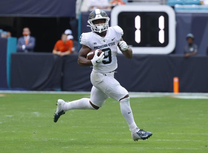 MIAMI GARDENS, FL - SEPTEMBER 18: Kenneth Walker III #9 of the Michigan State Spartans runs with the ball against the Miami Hurricanes on September 18, 2021 at Hard Rock Stadium in Miami Gardens, Florida. . (Photo by Joel Auerbach/Getty Images)