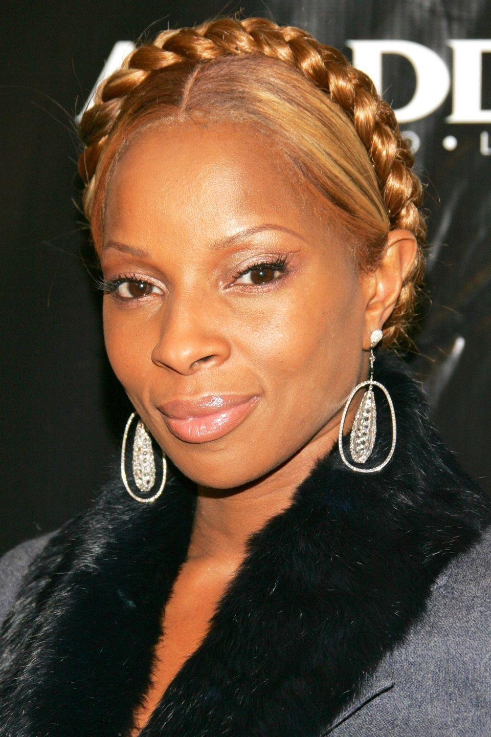 """<p>""""This Goddess braid is the exact same one I am wearing on the cover of my '<a href=""""https://www.amazon.com/Breakthrough-Mary-J-Blige/dp/B000BNTM32"""" rel=""""nofollow noopener"""" target=""""_blank"""" data-ylk=""""slk:Breakthrough"""" class=""""link rapid-noclick-resp"""">Breakthrough</a>' album. I wanted to be intentional at this point in my career. It's a very powerful, queen look for me―I'm in control of my life and my destiny. I was also doing more minimal makeup during this time because I wanted people to really see me.""""</p>"""