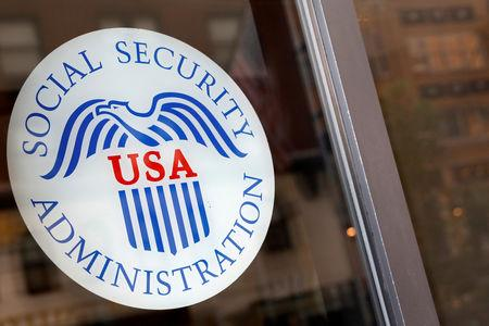 FILE PHOTO Sign is seen on the entrance to a Social Security office in New York