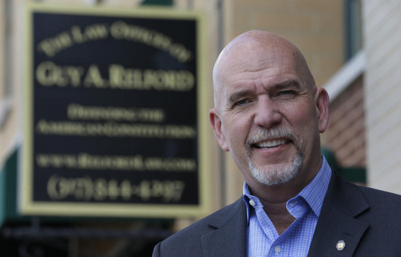 In this photo taken on Friday, April 18, 2014, Guy Relford, an attorney specializing in gun rights, poses outside his law office in Carmel, Ind. Redford is also the owner and instructor at Tactical Firearms Training teaching firearm safety as well as a comprehensive Indiana gun law course. (AP Photo/Michael Conroy)