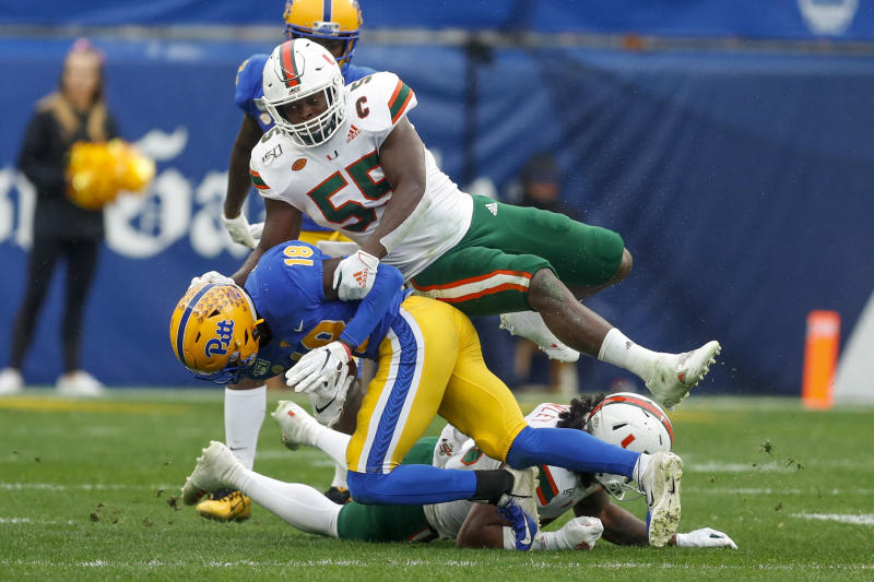 FILE - In this Oct. 26, 2019, file photo, Miami linebacker Shaquille Quarterman (55) tackles Pittsburgh wide receiver Shocky Jacques-Louis (18) during the second half of an NCAA college football game, in Pittsburgh. Quartermanwas selected to The Associated Press All-Atlantic Coast Conference football team, Tuesday, Dec. 10, 2019. (AP Photo/Keith Srakocic, File)