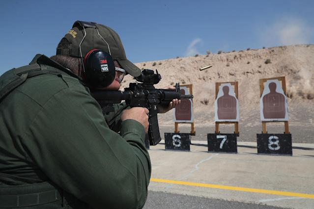 <p>A U.S. Border Patrol trainee fires his M-4 rifle during a weapons training class at the U.S. Border Patrol Academy on August 3, 2017 in Artesia, New Mexico. N.M. (Photo: John Moore/Getty Images) </p>