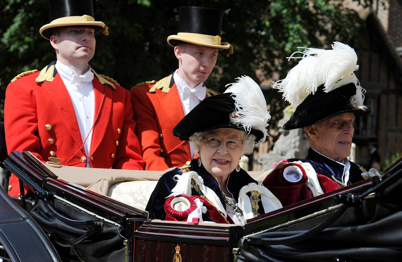 WINDSOR, ENGLAND - JUNE 18:   Queen ELizabeth II and Prince Philip, Duke of Edinburgh leave the annual Order of the Garter Service at St George's Chapel, Windsor Castle on June 18, 2011 in Windsor, England. The Order of the Garter is the senior and oldest British Order of Chivalry, founded by Edward III in 1348. Membership in the order is limited to the sovereign, the Prince of Wales, and no more than twenty-four members.  (Photo by Paul Hackett - WPA Pool/Getty Images)