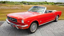 """<p>April 17, 1964, is a legendary date for muscle car lovers because that's when the Ford Mustang famously debuted at the World's Fair in New York. It was a success right out of the box thanks to its look, performance and price tag (starting at $2,300). Ford wanted the Mustang to be the """"working man's Thunderbird,"""" and it didn't disappoint, landing on the cover of both Time and Newsweek magazines. The 1 millionth Mustang rolled off the assembly line less than two years after it debuted. Just how cool was this pony car? It made an appearance in the convertible form in the James Bond movie """"Goldfinger."""" And we probably don't even need to mention its starring role in Steve McQueen's """"Bullitt"""" in 1968.</p>"""