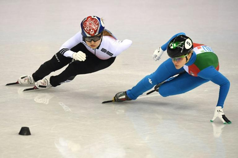 Choi Min-jeong (L) was disqualified in the women's 500m short track, as Italy's Arianna Fontana took gold