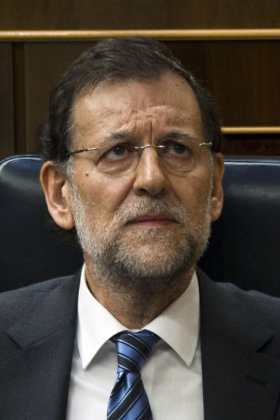 Spain's Prime Minister Mariano Rajoy looks up during a control session at the Spanish Parliament, in Madrid, Wednesday, June 13, 2012. The interest rate Spain would have to pay to raise money on the world's bond markets continued to rise Wednesday amid worries that a planned bank bailout might not be enough to save the country from needing an overall financial rescue. (AP Photo/Daniel Ochoa de Olza)