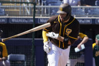 San Diego Padres' Victor Caratini tosses his bat after a walk during the first inning of the team's spring training baseball game against the Oakland Athletics, Thursday, March 18, 2021, in Peoria, Ariz. (AP Photo/Sue Ogrocki)