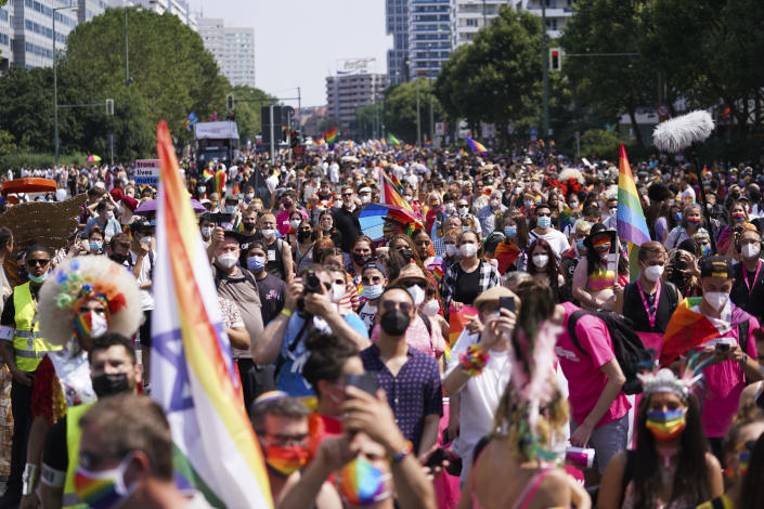 """People take part in the Christopher Street Day (CSD) parade, in Berlin, Saturday, July 24, 2021. The official motto of the CSD is """"Save our Community - save our Pride"""". (J'rg Carstensen/dpa via AP)"""