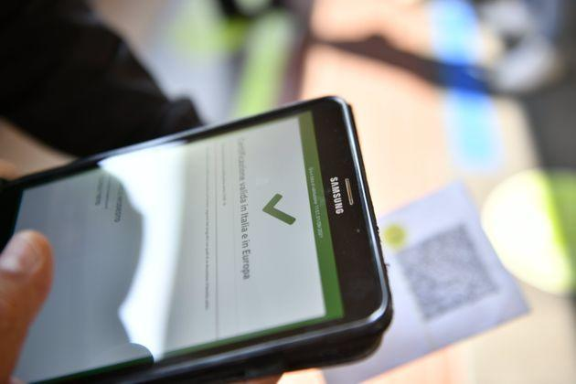 TURIN, ITALY - SEPTEMBER 01: A Green Pass on smartphone inside the Porta Nuova Station on September 1, 2021 in Turin, Italy. Italy's so-called Green Pass has been extended as of September 1 to transport and education sectors. (Photo by Stefano Guidi/Getty Images) (Photo: Stefano Guidi via Getty Images)