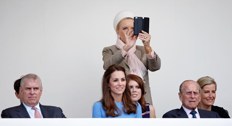 LONDON, UNITED KINGDOM - JUNE 12: (EMBARGOED FOR PUBLICATION IN UK NEWSPAPERS UNTIL 48 HOURS AFTER CREATE DATE AND TIME) Princess Michael of Kent takes photographs on her mobile phone as she, Prince Andrew, Duke of York, Catherine, Duchess of Cambridge, Princess Eugenie, Prince Philip, Duke of Edinburgh and Sophie, Countess of Wessex watch a carnival parade as they attend 'The Patron's Lunch' celebrations to mark Queen Elizabeth II's 90th birthday on The Mall on June 12, 2016 in London, England. (Photo by Max Mumby/Indigo/Getty Images)
