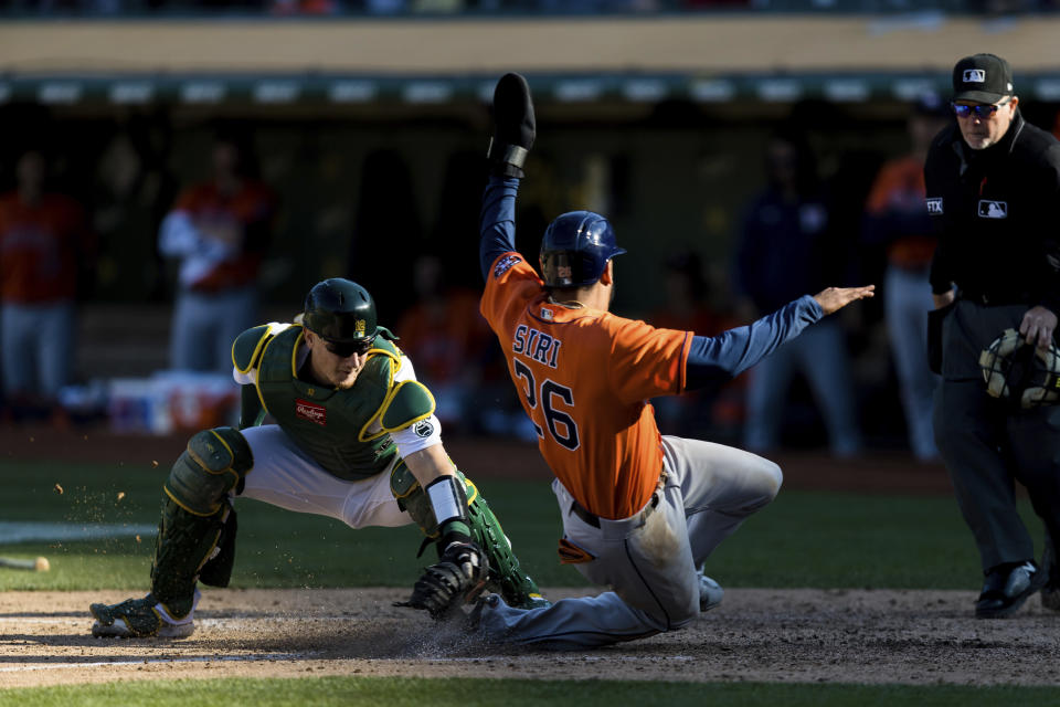 Oakland Athletics catcher Sean Murphy, left, tags out Houston Astros' Jose Siri (26) in the ninth inning of a baseball game in Oakland, Calif., Sunday, Sept. 26, 2021. (AP Photo/John Hefti)