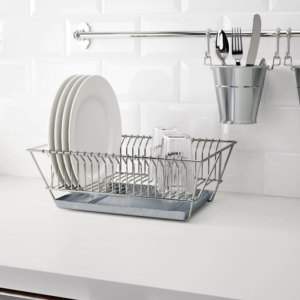 "<p>The <a href=""https://www.popsugar.com/buy/Fintorp%20Dish%20Drainer-446977?p_name=Fintorp%20Dish%20Drainer&retailer=ikea.com&price=15&evar1=casa%3Aus&evar9=46151613&evar98=https%3A%2F%2Fwww.popsugar.com%2Fhome%2Fphoto-gallery%2F46151613%2Fimage%2F46152163%2FFintorp-Dish-Drainer&list1=shopping%2Cikea%2Corganization%2Ckitchens%2Chome%20shopping&prop13=api&pdata=1"" rel=""nofollow noopener"" target=""_blank"" data-ylk=""slk:Fintorp Dish Drainer"" class=""link rapid-noclick-resp"">Fintorp Dish Drainer</a> ($15) can be hung on the wall to make more counter space, or can be stored under the sink when it is not in use.</p>"