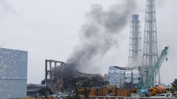 PHOTO: This handout photo shows the smoking No. 3 reactor building (C) and buildings of reactors No. 2 (L, front) and No. 4 (R, back) of the quake-hit Fukushima Daiichi Nuclear Power Station, March 21, 2011, in Fukushima Prefecture, Japan. (Kyodo News Stills via Getty Images)