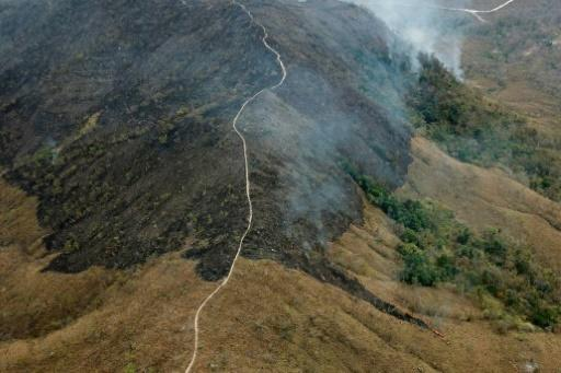 Handout aerial picture released by the Mato Grosso Fire Department showing burnt areas of land in the hills of the municipality of Chadapa dos Guimaraes in Mato Grosso State, in west-central Brazil, on August 23, 2019