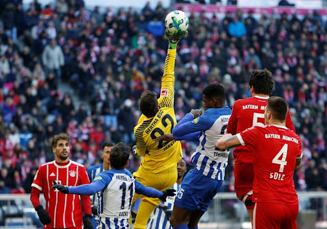 Soccer Football - Bundesliga - Bayern Munich vs Hertha BSC - Allianz Arena, Munich, Germany - February 24, 2018 Hertha Berlin's Rune Jarstein makes a save REUTERS/Michaela Rehle DFL RULES TO LIMIT THE ONLINE USAGE DURING MATCH TIME TO 15 PICTURES PER GAME. IMAGE SEQUENCES TO SIMULATE VIDEO IS NOT ALLOWED AT ANY TIME. FOR FURTHER QUERIES PLEASE CONTACT DFL DIRECTLY AT + 49 69 650050