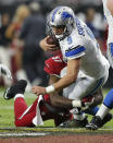 Detroit Lions quarterback Matthew Stafford (9) is sacked by Arizona Cardinals outside linebacker Alex Okafor (57) during the second half of an NFL football game, Sunday, Nov. 16, 2014, in Glendale, Ariz. (AP Photo/Ralph Freso)