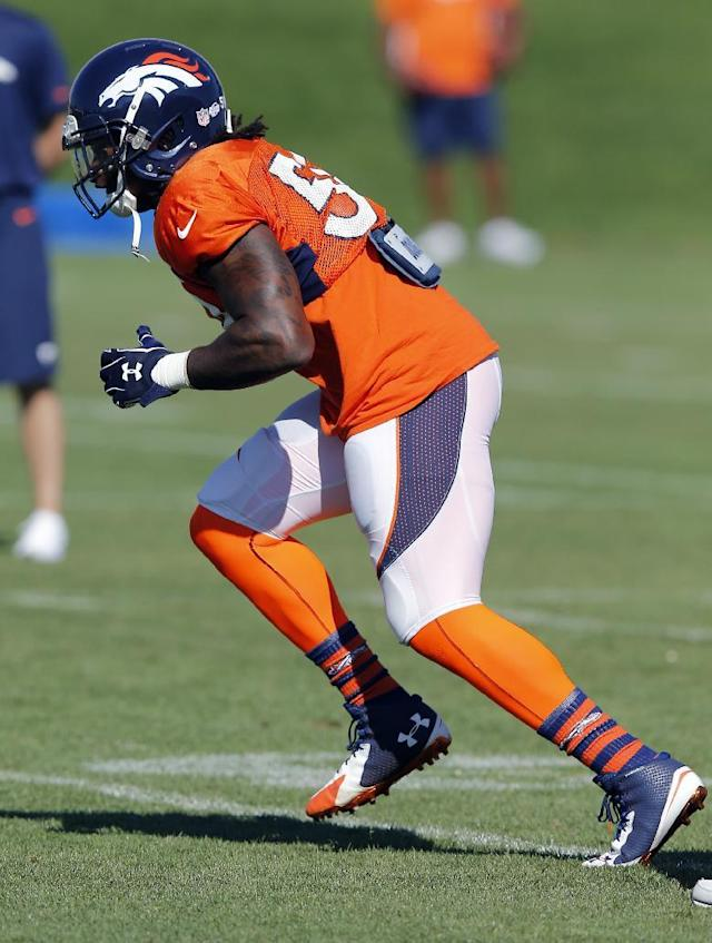 Denver Broncos' Danny Trevathan runs a drill during NFL football training camp on Tuesday, Aug 12, 2014, in Englewood, Colo. Trevathan was injured later in practice. (AP Photo/Jack Dempsey)