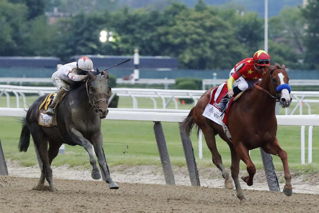 Justify (1), with jockey Mike Smith up, leads Gronkowski (6), with jockey Jose Ortiz up, down the stretch before winning the 150th running of the Belmont Stakes horse race, Saturday, June 9, 2018, in Elmont, N.Y. (AP Photo/Julie Jacobson)