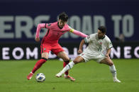 South Korea's Son Heung-min fights for the ball against Iraq's Sherko Kareem Gubari during the final round of their Asian zone group A qualifying soccer match for the FIFA World Cup Qatar 2022 at Seoul World Cup stadium in Seoul, South Korea, Thursday, Sept. 2, 2021. (AP Photo/Lee Jin-man)