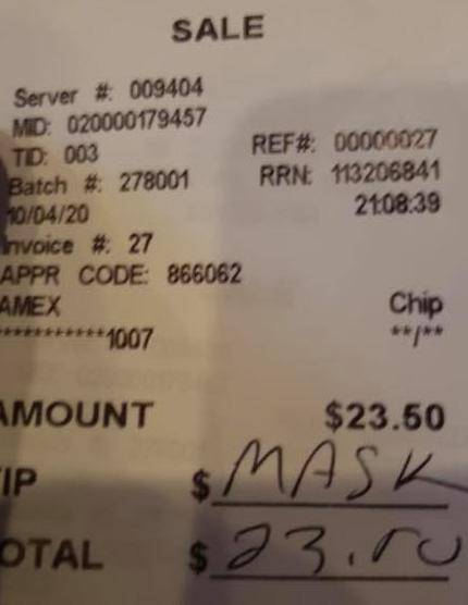 A receipt from a restaurant with 'mask' written in the tip section.