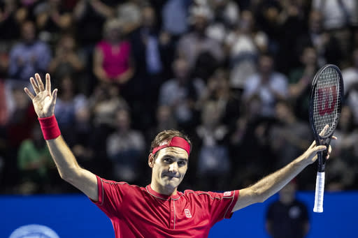 Roger Federer of Switzerland reacts after winning the semifinal match against Stefanos Tsitsipas of Greece at the Swiss Indoors tennis tournament at the St. Jakobshalle in Basel, Switzerland, Saturday, Oct. 26, 2019. (Alexandra Wey/Keystone via AP)