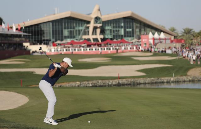 Brooks Koepka from the U.S. plays a shot on the 18th fairway during the second round of the Abu Dhabi Championship golf tournament in Abu Dhabi, United Arab Emirates, Friday, Jan. 17, 2020. (AP Photo/Kamran Jebreili)
