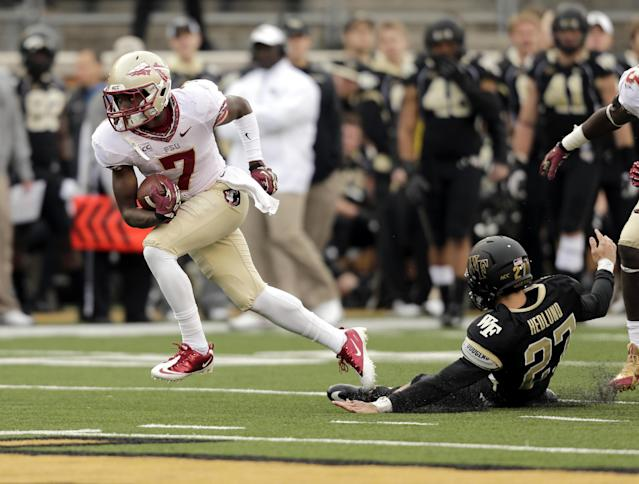 "Florida State's Levonte ""Kermit"" Whitfield, left, breaks away from Wake Forest kicker Chad Hedlund on the way to a touchdown in the second half of an NCAA college football game in Winston-Salem, N.C., Saturday, Nov. 9, 2013. (AP Photo/Nell Redmond)"