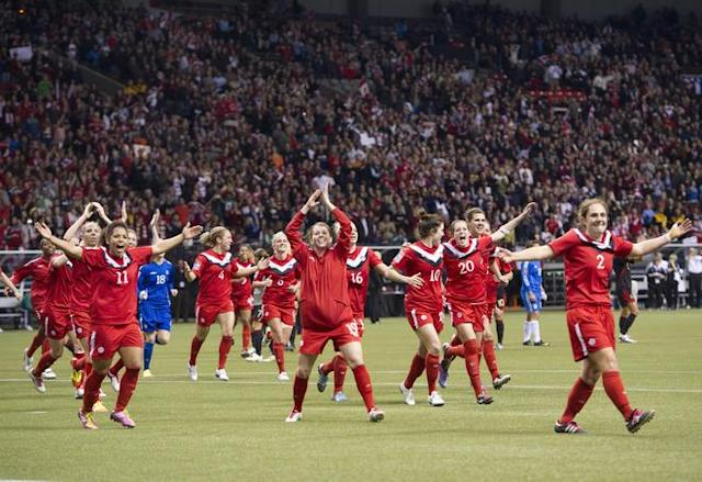 VANCOUVER, CANADA - JANUARY 27: Team Canada salutes their fans after defeating Mexico 3-1 during the semifinals of the 2012 CONCACAF Women's Olympic Qualifying Tournament at BC Place on January 27, 2012 in Vancouver, British Columbia, Canada. Canada qualified for the 2012 Summer Olympic Games in London (Photo by Rich Lam/Getty Images)