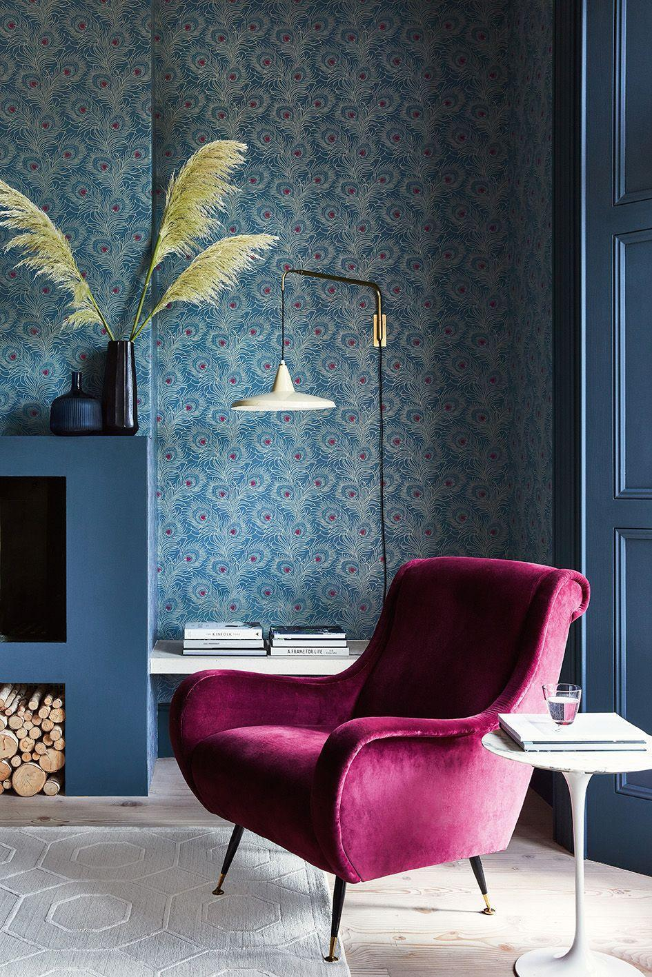 """<p>The colour blue can make you feel calm and relaxed or vibrant and energised, and can work well in a living room. Complement an all-blue scheme with blue paint on doors and around fireplaces, and printed wallpaper on the four walls. This flamboyant peacock feather design provides a splash of colour.</p><p>Pictured: Carlton House Terrace - Blue Plume, <a href=""""https://www.littlegreene.com/wallpaper/collection/london-wallpapers/v/carlton-house-terrace/carlton-house-terrace-blue-plume"""" rel=""""nofollow noopener"""" target=""""_blank"""" data-ylk=""""slk:Little Greene"""" class=""""link rapid-noclick-resp"""">Little Greene</a></p>"""