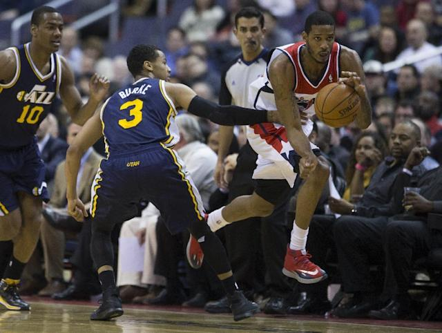 Utah Jazz point guard Alec Burks (10) and guard Trey Burke (3) watch as Washington Wizards small forward Trevor Ariza steals the ball during the first half of an NBA basketball game on Wednesday, March 5, 2014, in Washington. (AP Photo/ Evan Vucci)