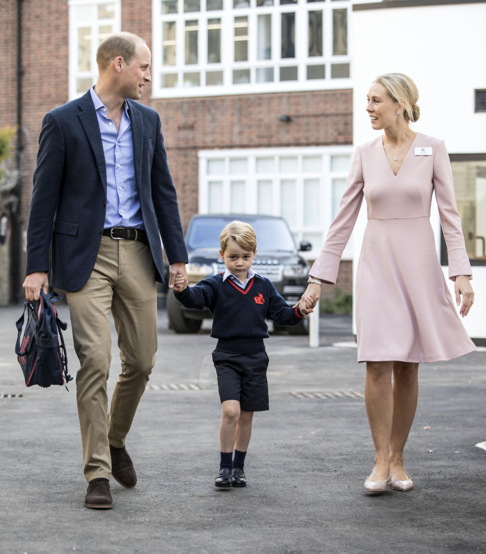 Britain's Prince George (C) accompanied by Britain's Prince William (L), Duke of Cambridge arrives for his first day of school at Thomas's school where he is met by Helen Haslem (R) head of the lower school on September 7, 2017 in southwest London. / AFP PHOTO / POOL / RICHARD POHLE        (Photo credit should read RICHARD POHLE/AFP/Getty Images)