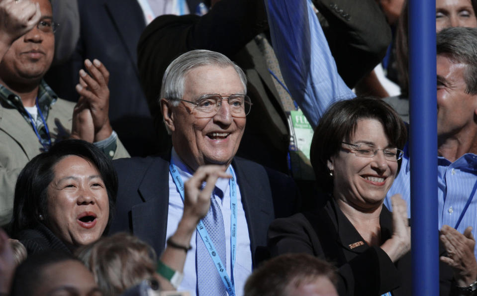 FILE - In this Wednesday, Aug. 27, 2008, file photo, former Vice President Walter Mondale, center, and Sen. Amy Klobuchar, D-Minn., right, are seen after announcing their presidential nominee during the roll call of states on the third day of the Democratic National Convention in Denver. Mondale, a liberal icon who lost the most lopsided presidential election after bluntly telling voters to expect a tax increase if he won, died Monday, April 19, 2021. He was 93. (AP Photo/Charlie Neibergall, File)