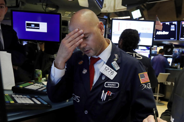 Specialist Mario Picone works on the floor of the New York Stock Exchange, Wednesday, Aug. 14, 2019. The Dow Jones Industrial Average sank 800 points after the bond market flashed a warning sign about a possible recession for the first time since 2007. (AP Photo/Richard Drew)